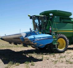 The Jurises' stripper header, mounted on their combine
