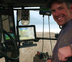 Eric Odberg drives farm machinery equipped with screens for use in precision agriculture.